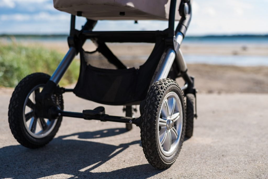 Baby stroller on beach